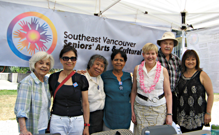 Left to right: Lorna Gibbs, SVSACS president; Beatrice Ho; Mabel Leung; Ramesh Kalia; Hon. Suzanne Anton, MLA; George Grant, SVSACS secretary; and MP Wai Young. SVSACS display booth, Champlain Heights Community Centre Summer Fair, June 6, 2015. COURTESY: George Grant