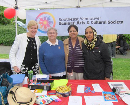 Champlain Summer Fair, June 2013. B.C. Minister of Justice Suzanne Anton visits with Southeast Vancouver Seniors Arts and Cultural Centre members who are soliciting donations and providing information to seniors.